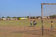 Children playing football in football park