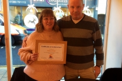 Paul presenting certificate to Eileen