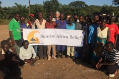 Makala village with Sunrise Africa Relief banner