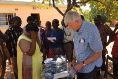 Robert sorting glasses in Sandwe village