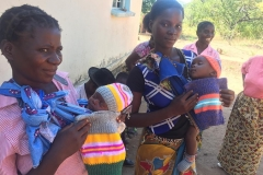 Local infants wearing their new knitting
