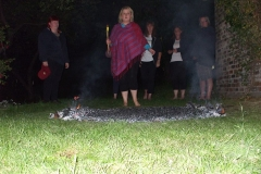 Lynda begins her walk across hot embers