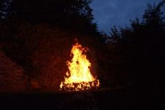 The wood has been lit and now is a roaring fire