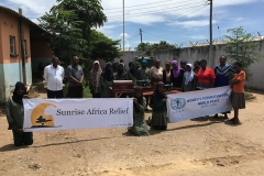 Chipata Mosque holding Sunrise Africa Relief and Women's Federation for World Peace Banners